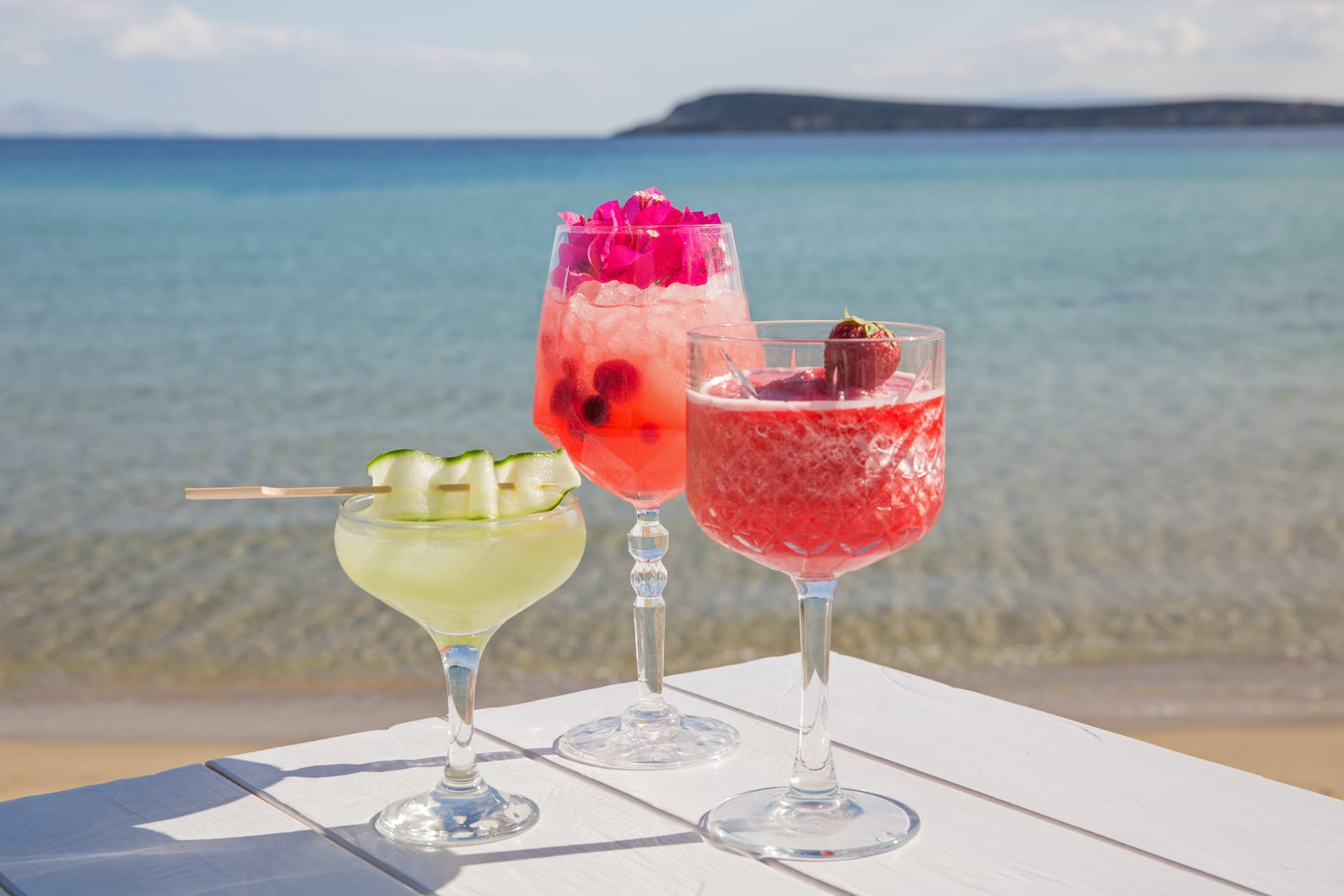 Colourful and tasty cocktails against the sea, on the golden beach in Paros.