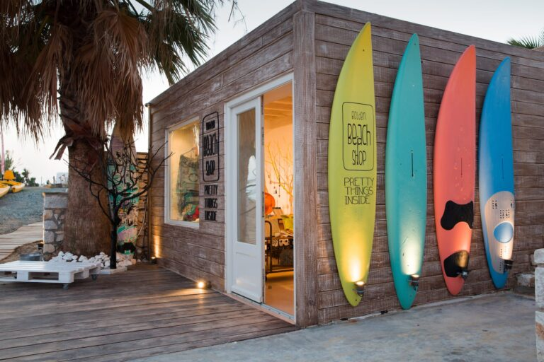 The Golden Beach Shop in Paros with surf boards outside.