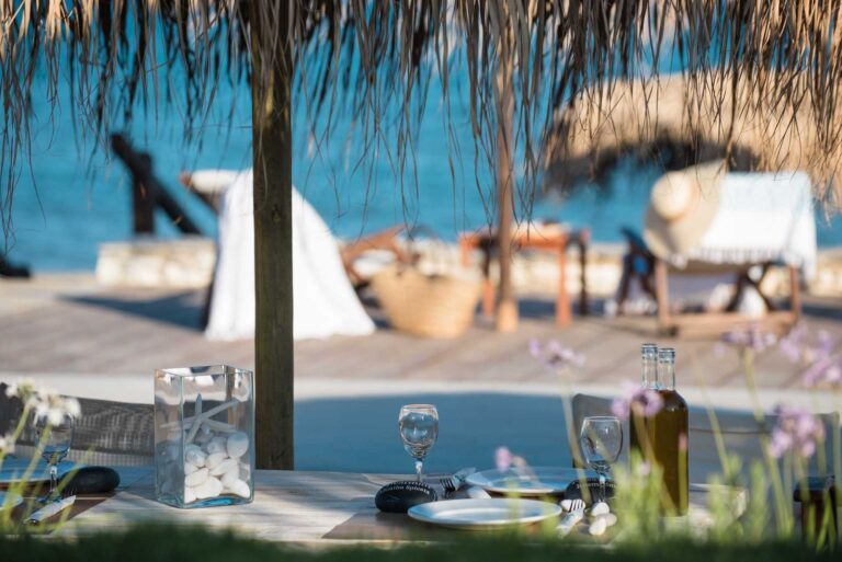 Table prepared for a meal located on the beachfront side of the Golden Beach Hotel restaurant in Paros.
