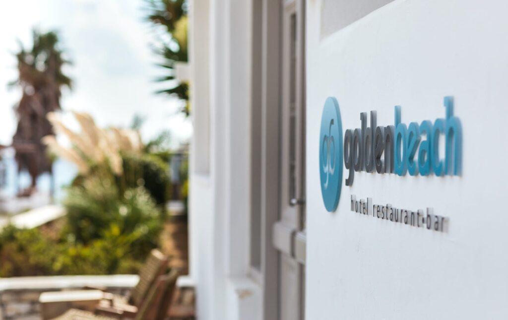 Logo of the 4-star beachfront Golden Beach Hotel, Restaurant and Bar in Paros.